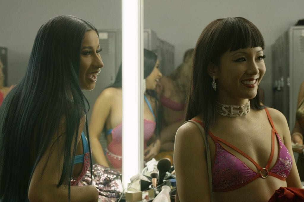 Two women smiling in a dressing room