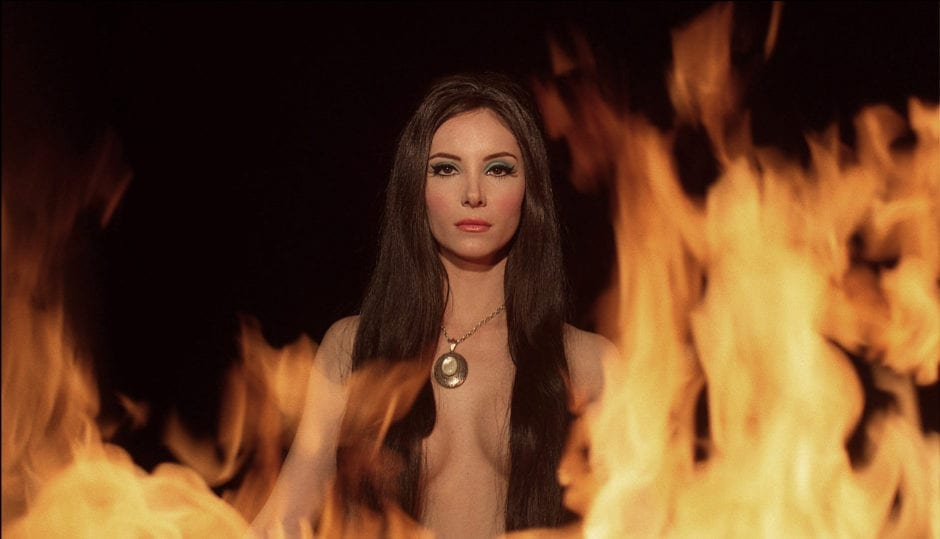 the love witch with flames around her