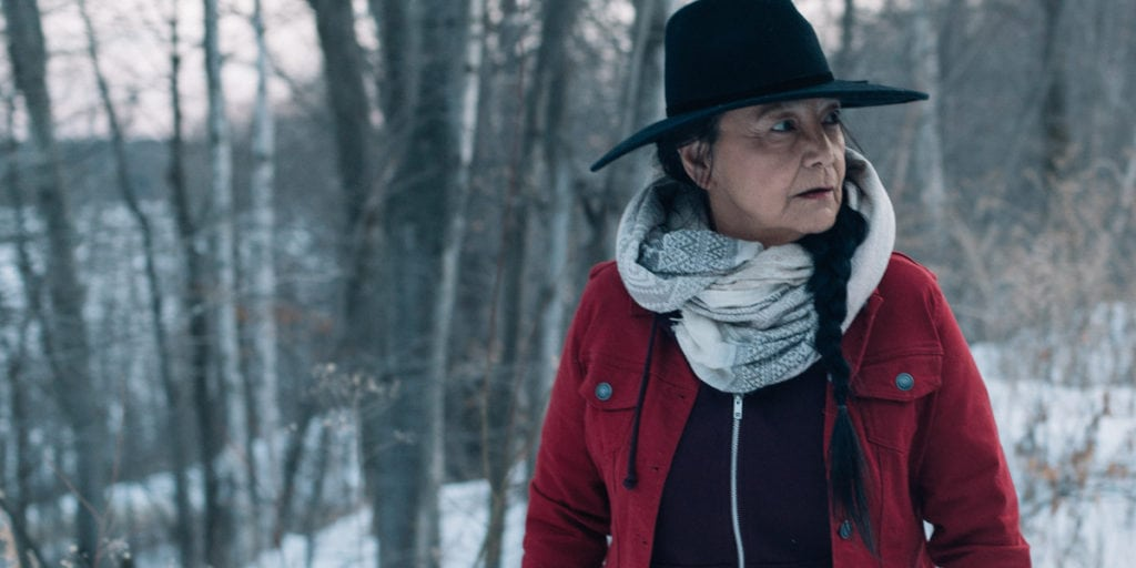 Tantoo Cardinal in a forest