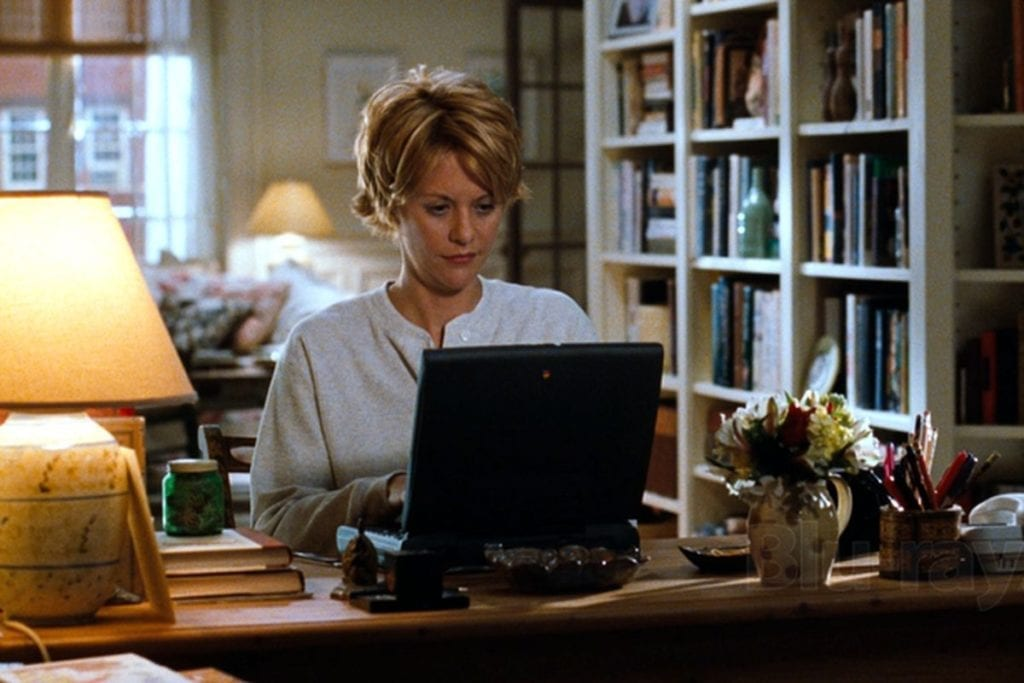 meg ryan sitting at her computer