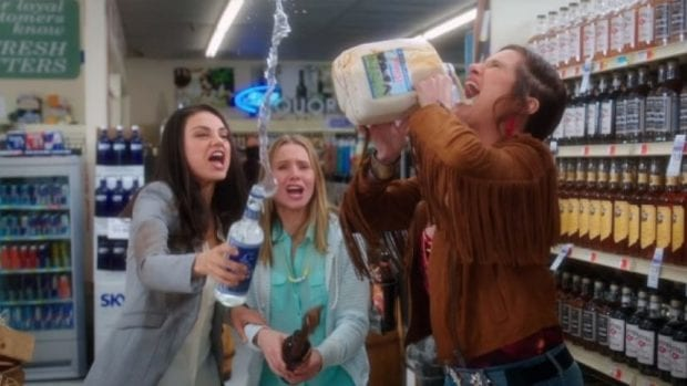 still from Bad Moms, Kathryn Hahn chugs something