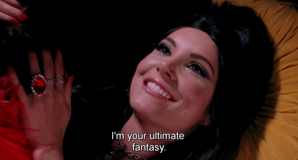 still from the Love Witch featuring a smiling woman