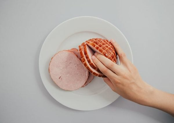 suggestive image of fingers inside of a ham